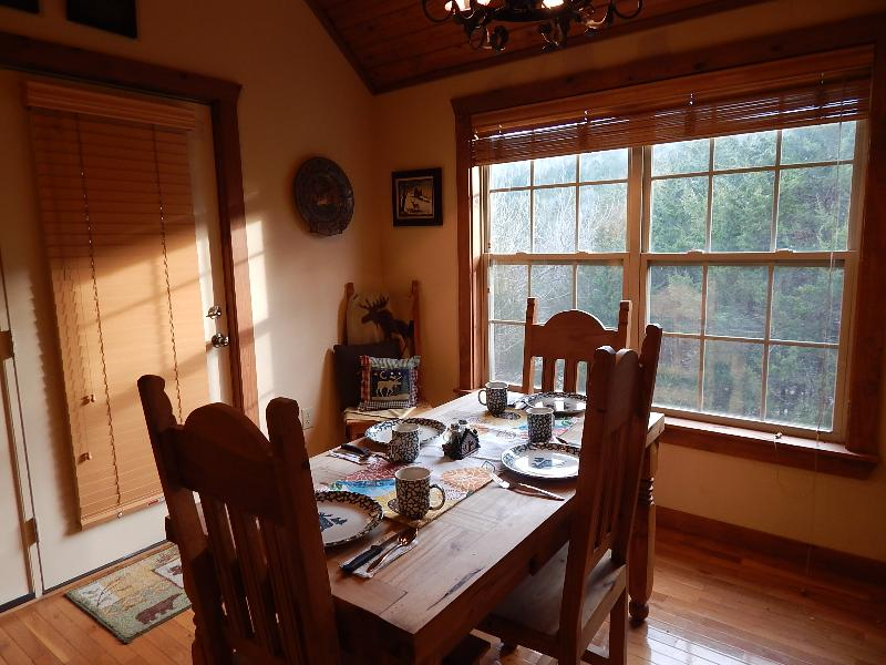 Dining Room table with views of the woods from our back windows