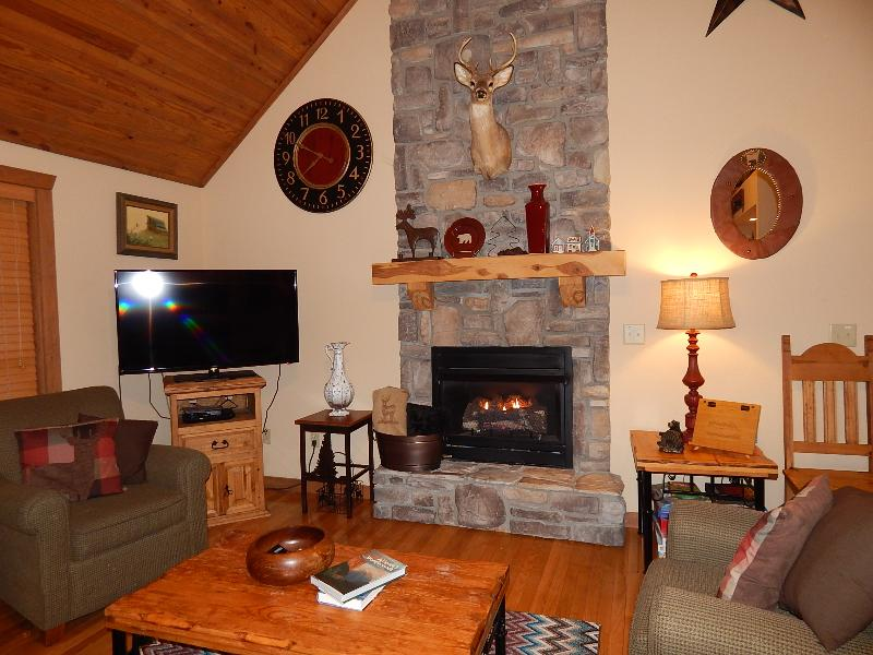 Living Room with cozy fireplace and flat screen TV