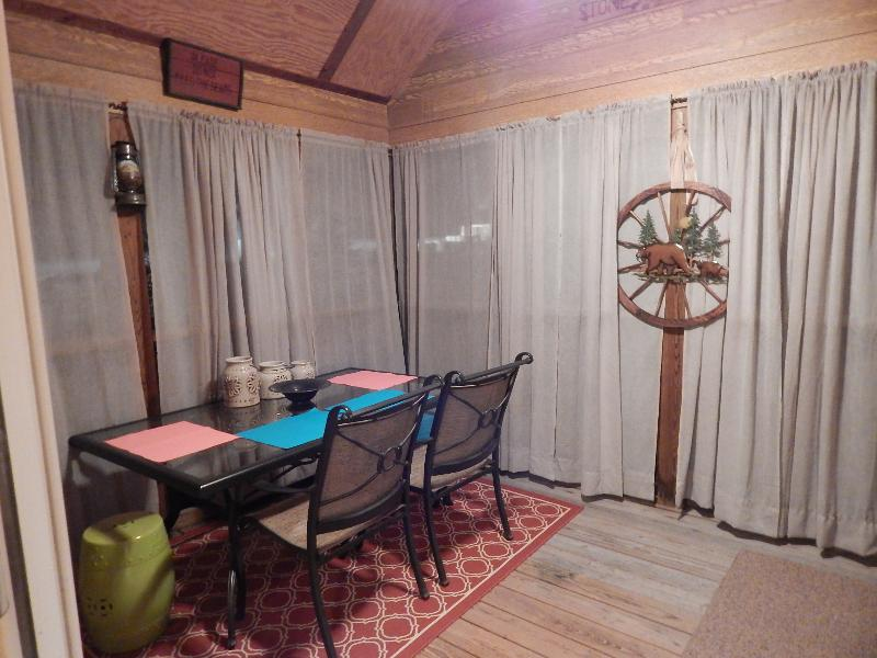 Screened porch access directly off cabin.  View to the left is toward the front