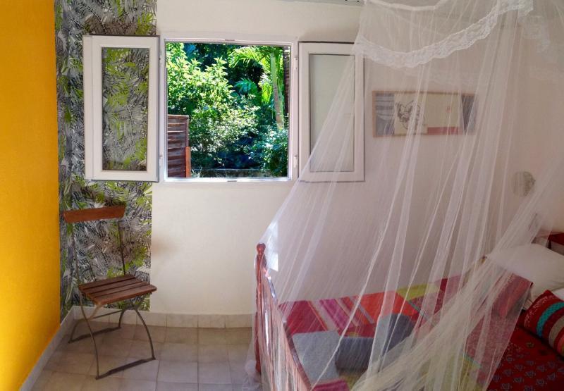 Repos garanti dans un écrin de végétation tropicale...