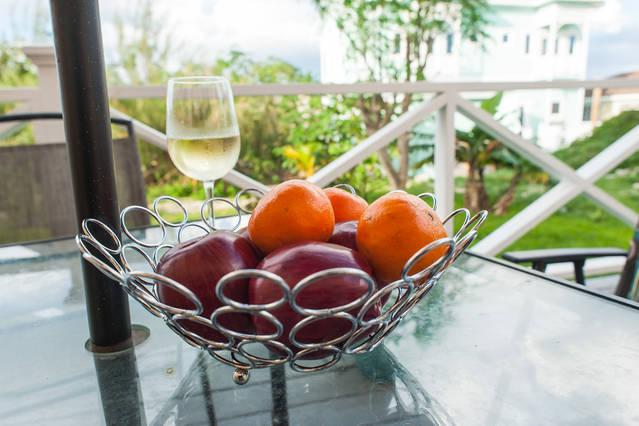 Enjoy a glass of wine and cool island breeze on patio.