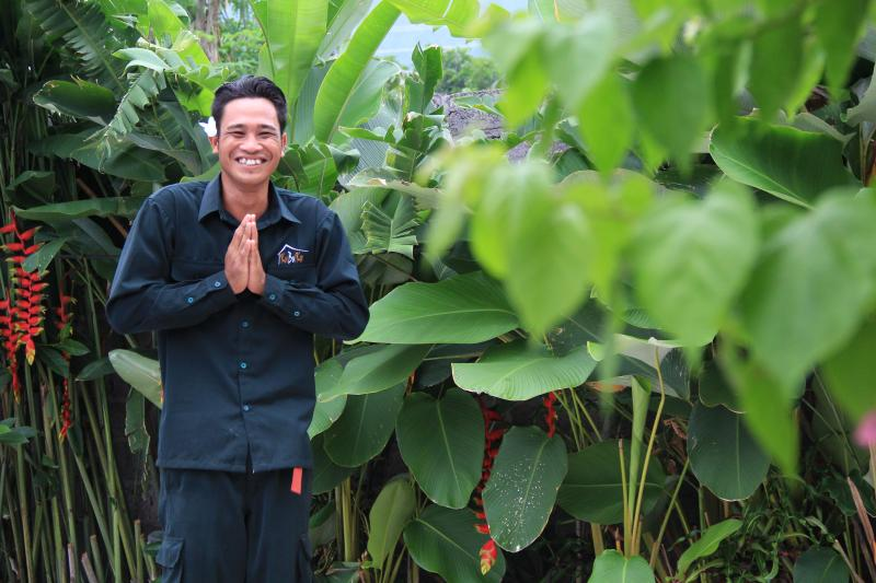 Wayan  He is smilling guy and he love Garden,flowers and green yard