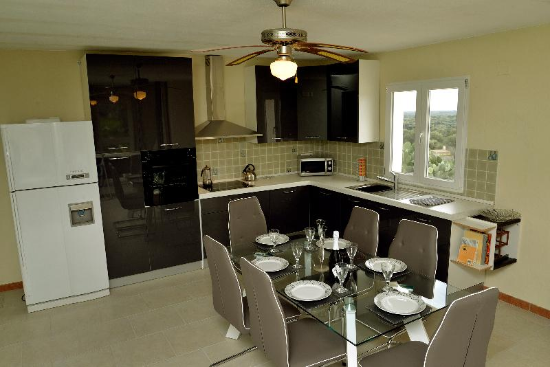 View of large well equipped open plan Kitchen Dining Area leads to TV area also open plan.