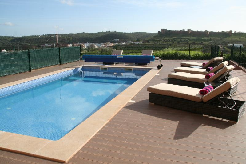 Private Pool can be heated with 6 Rattan sun loungers and two parasols.