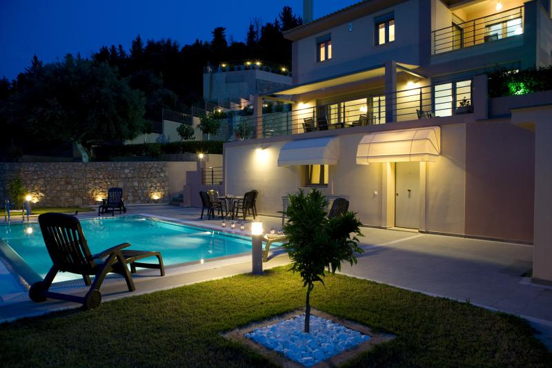Exterior area of the villa. Private swimming pool with garden,sunbeds
