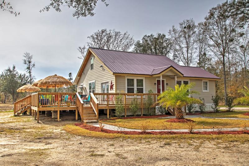 Book your Midway escape to this 4-bedroom, 2-bath vacation rental house!