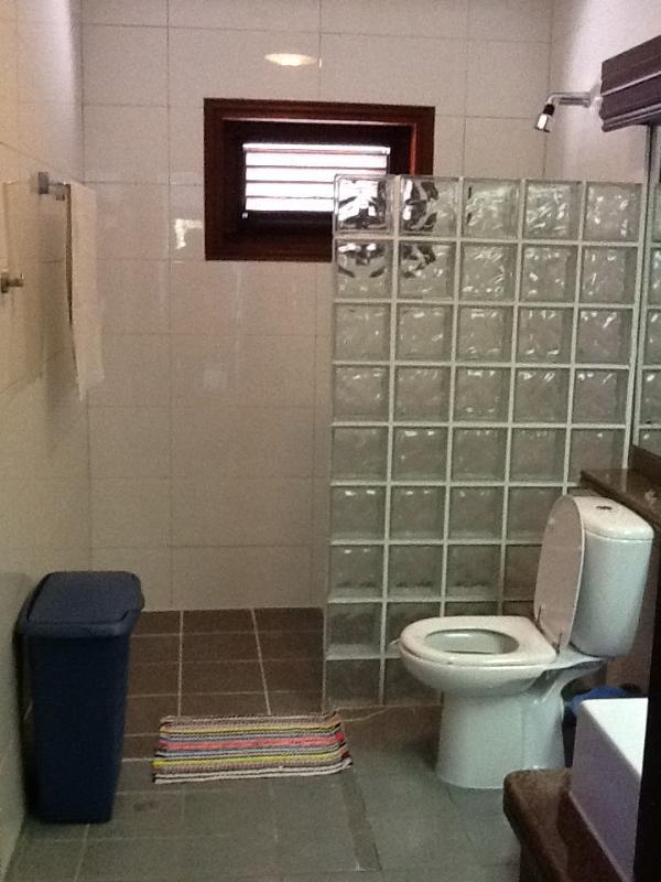 Modern bathroom with shower, wc, bidet and sink.