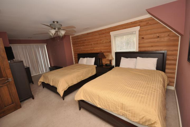 BR#3 has two queen beds, plush carpeting, and deck access.