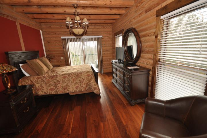 BR#1 has queen bed, sitting area, hardwood floors and deck access.