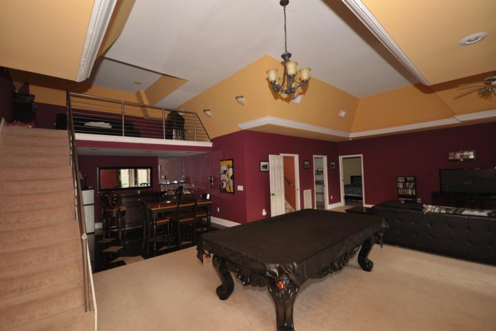 I can't forget to mention the gaming area with ornate billiards table wet bar and loft seating!