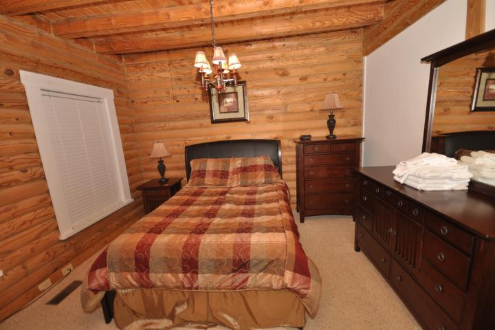 BR#4 houses king bed, beautiful wood furnishings, and soft carpet.