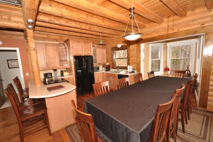 Open kitchen and dining gives maximum space for guests- table seats 10 and counter seats 3.