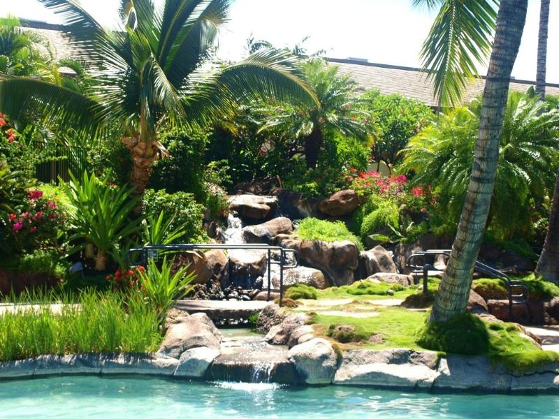 Tropical waterfall at relaxing upper pool. There are 2 pools, both with hot tubs for your pleasure.