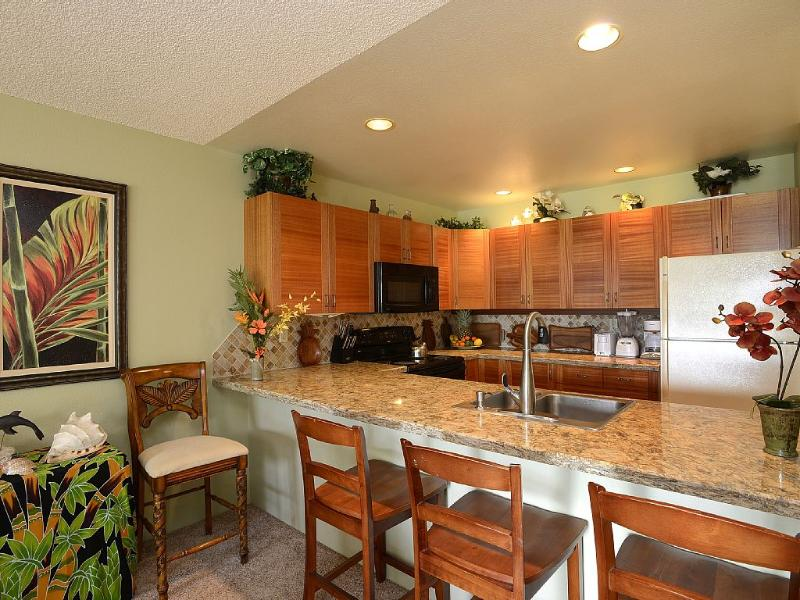 Fully-stocked kitchen has all major appliances and everything you need to cook and grill.