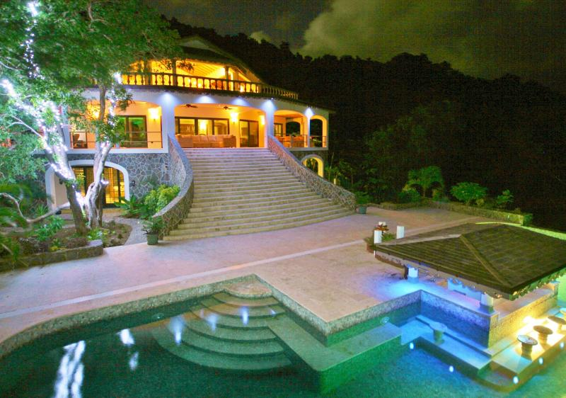 An evening view of Tropical Hideaway Villa and the Infinity Pool