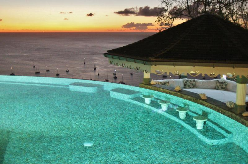 The Coral stone seats and pebble tiles are a wonderful feature of the Infinity Pool