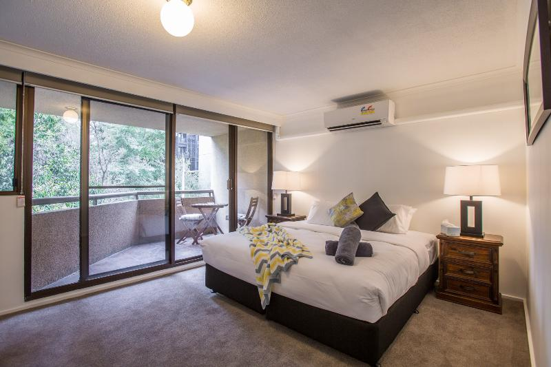 Huge king bedroom with private balcony, air-conditioning & ensuite in this four bedroom apartment