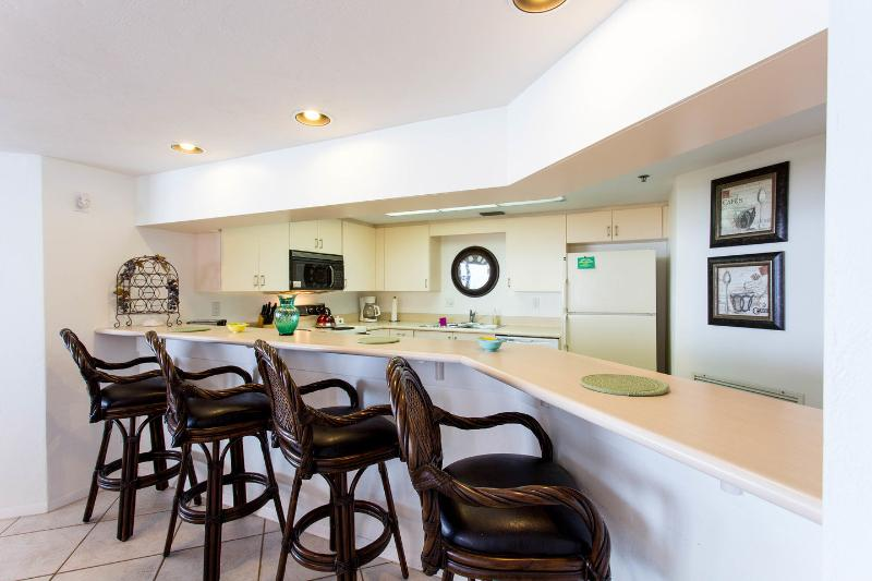 Kitchen (overlooks sweeping ocean views) and seats four at breakfast bar.
