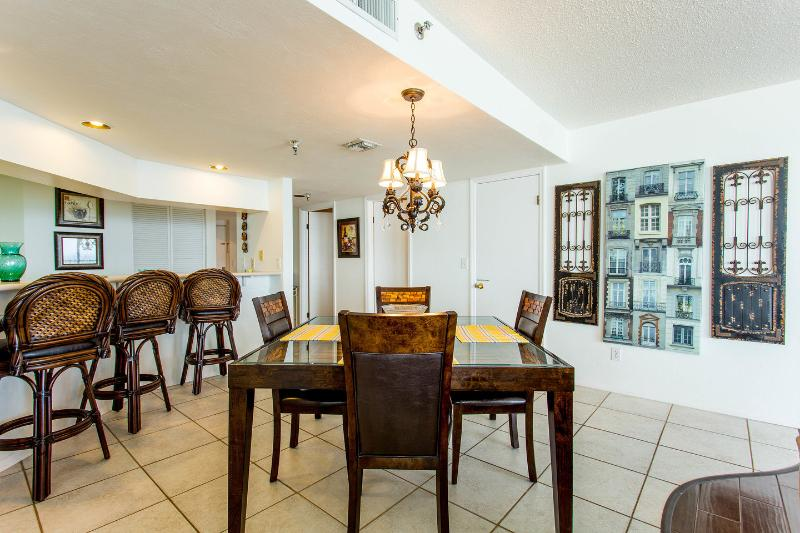 Dining Room: Beautiful Ebony Mango Wood table w SIX chairs. Total seating for TEN incl bar stools.