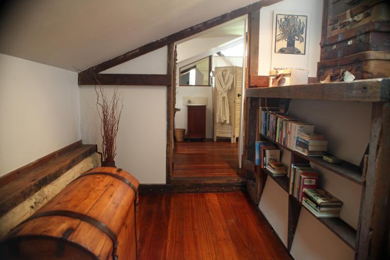 The mezzanine walkway between the upstairs bedroom and bathroom