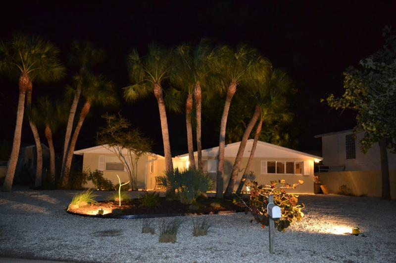 Front moonlit view. Circular driveway with ample parking. 5 minute walk to beach.