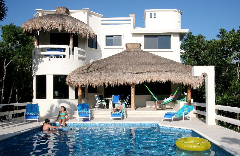 Shaded palapa with lounging and dining areas ..the perfect spot for Happy Hour