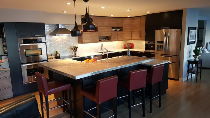 Beautiful chef's kitchen with two oven, and induction cooktop