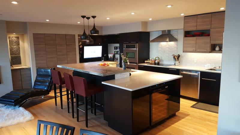 Great Kitchen Bar for hanging out with 42' computer monitor to share ideas