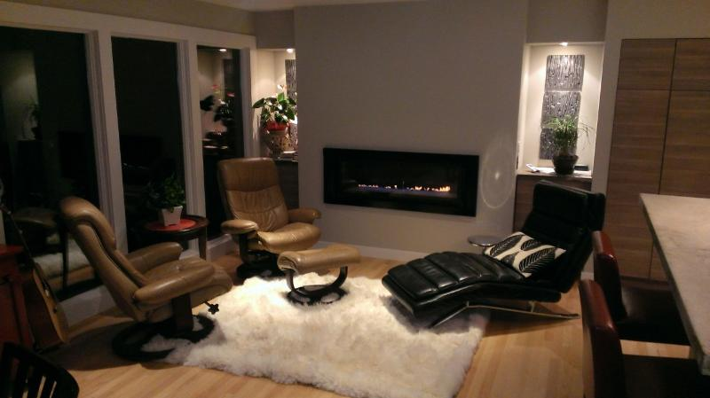 Hang out in the sitting area with gas fireplace