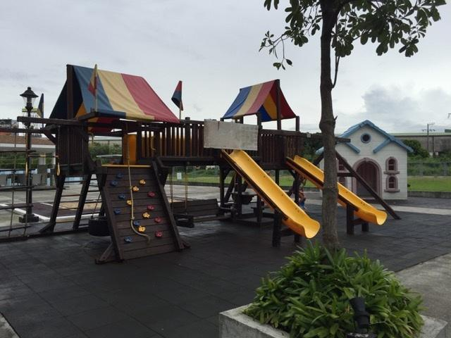 Kids play place with slides, swing, play house