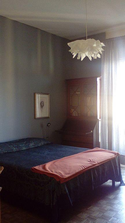 bedroom (with a double bed and a small desk)