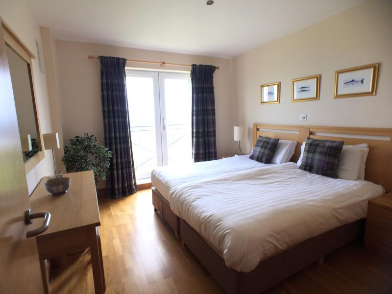 Bed 1 (King or twins) with french doors to outstanding sea views
