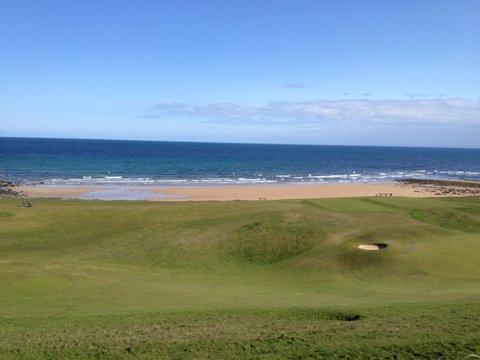 View directly out from Lounge, and both bedrooms to the golf, beach and sea