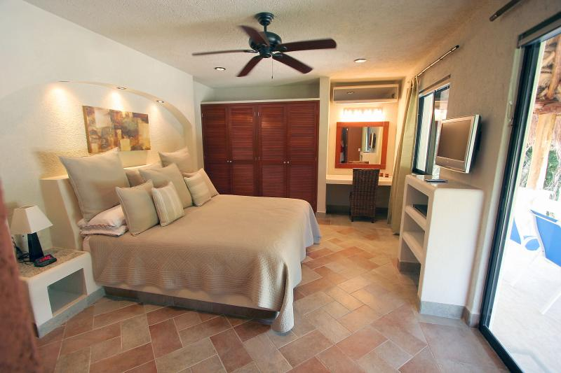 Luxurious king-size master bedroom with private bathroom, terrace and plasma TV