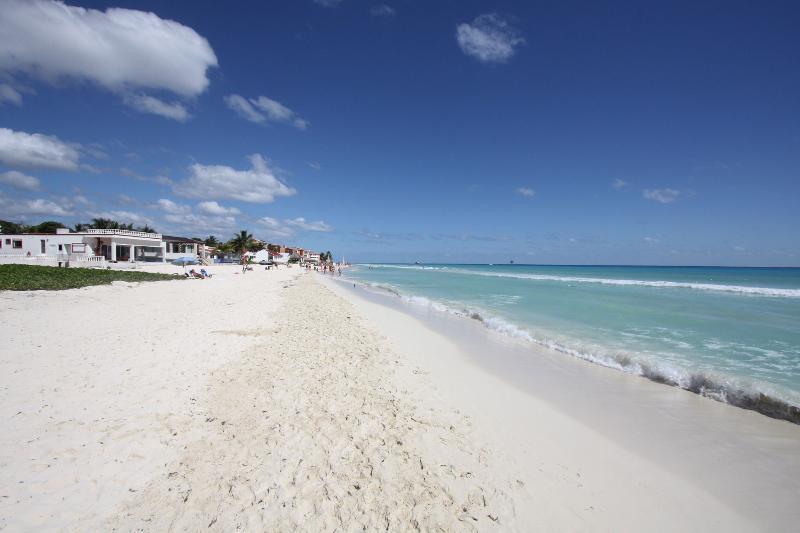 The Playacar Beach is a short walk away