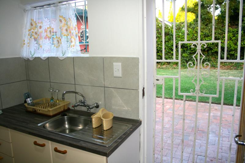 kitchenette with microwave and little stove