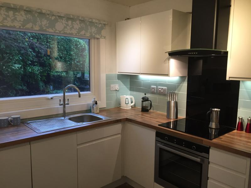 Fully fitted kitchen with integrated dishwasher, washer dryer,induction hob and multi function oven