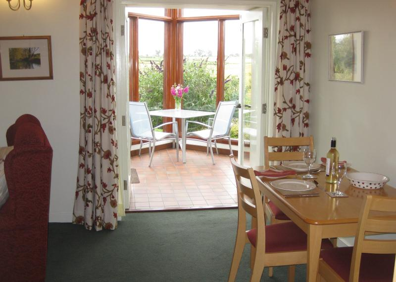 Level access to south facing conservatory from dining area of spacious living room.