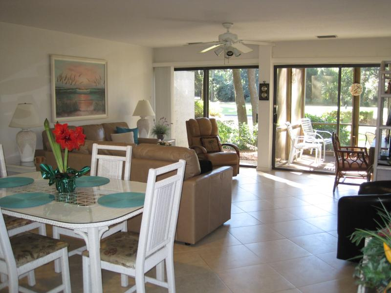 SPACIOUS DINING, LIVING ROOM AND SCREENED PORCH OVERLOOKING THE 9TH TEE OF HARBOUR TOWN GOLF COURSE