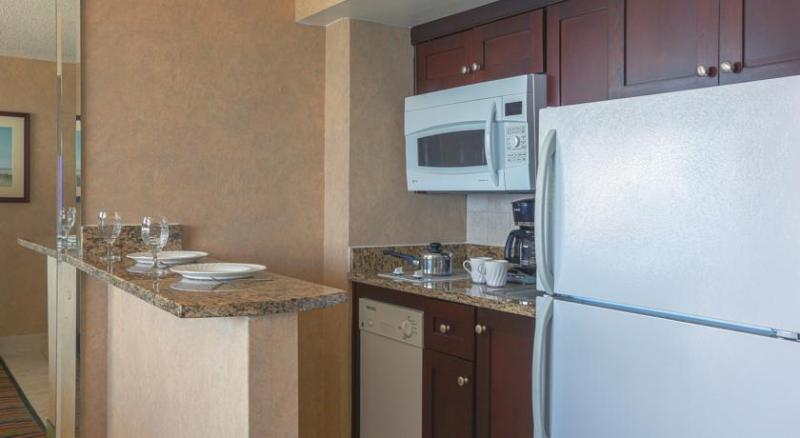 Kitchen with dishwasher, microwave, stove, and frig