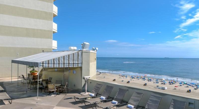 Roof top pool overlooking ocean.  Walk half a flight of stairs from room