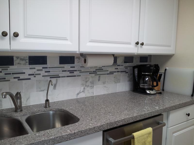 Kitchen Featuring Reverse Osmosis Faucet, Bosch Dishwasher, & Quartz Counter