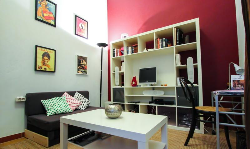 The living room has a sofa bed, TV with home cinema, and a small desk. Free high-speed Wifi