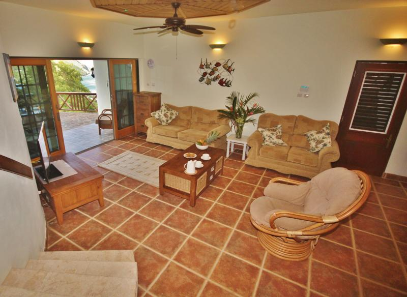 The living area is well furnished and has a lovely veranda overlooking the Caribbean Sea
