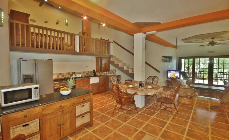 The kitchen area is very spacious and has professional quality equipment throughout