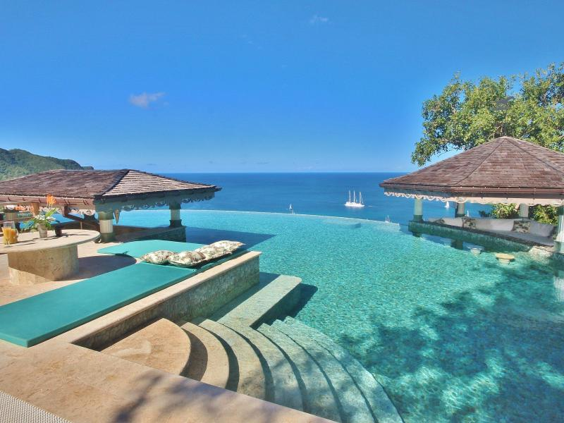 The Infinity Pool is tiled using natural stone pebbles and heated for all year round use