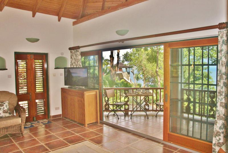 24' of glass patio doors lead onto the veranda with the most stunning views