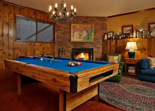 Game room with fireplace and screen tv