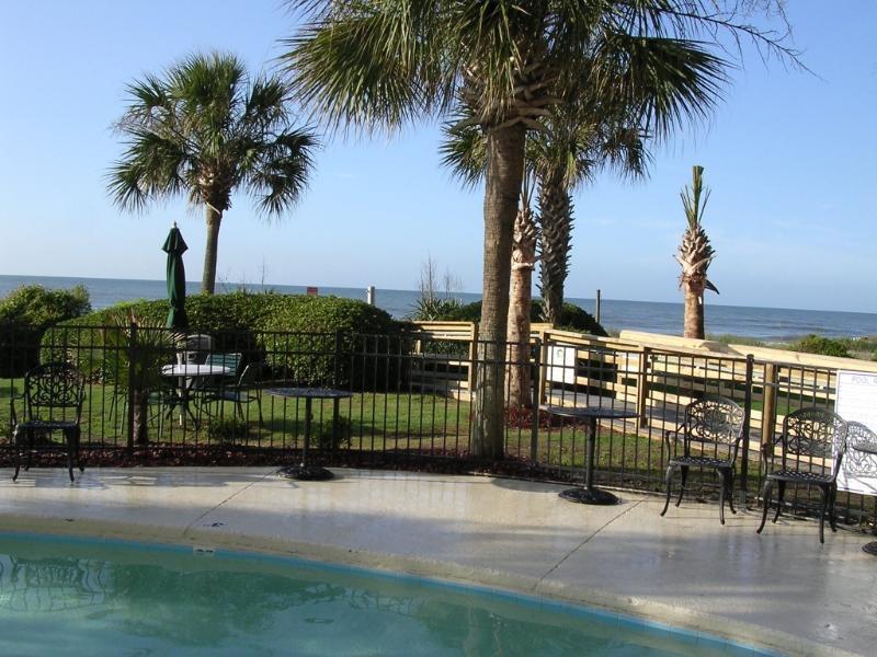 Palms resort outside heated pool