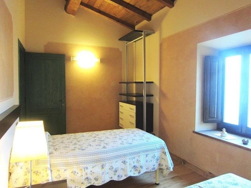 Twin room with beamed ceilings